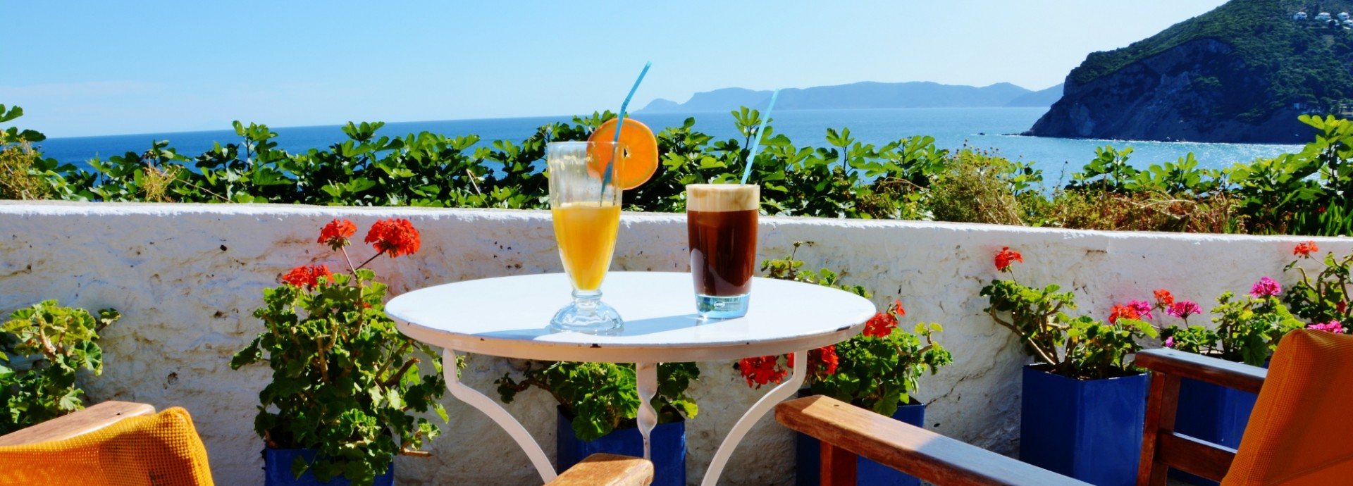 Morning coffee with a view on the cliffs in Skopelos Town