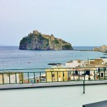 Rooftop drinks with a view of Castello Aragonese Ischia Island