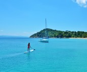 Stand Up Paddle Boarding whilst anchored at Koukounaries Beach on Skiathos Island