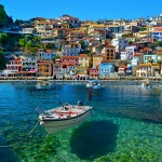 Parga Town Quay with colourful houses and fishing boats