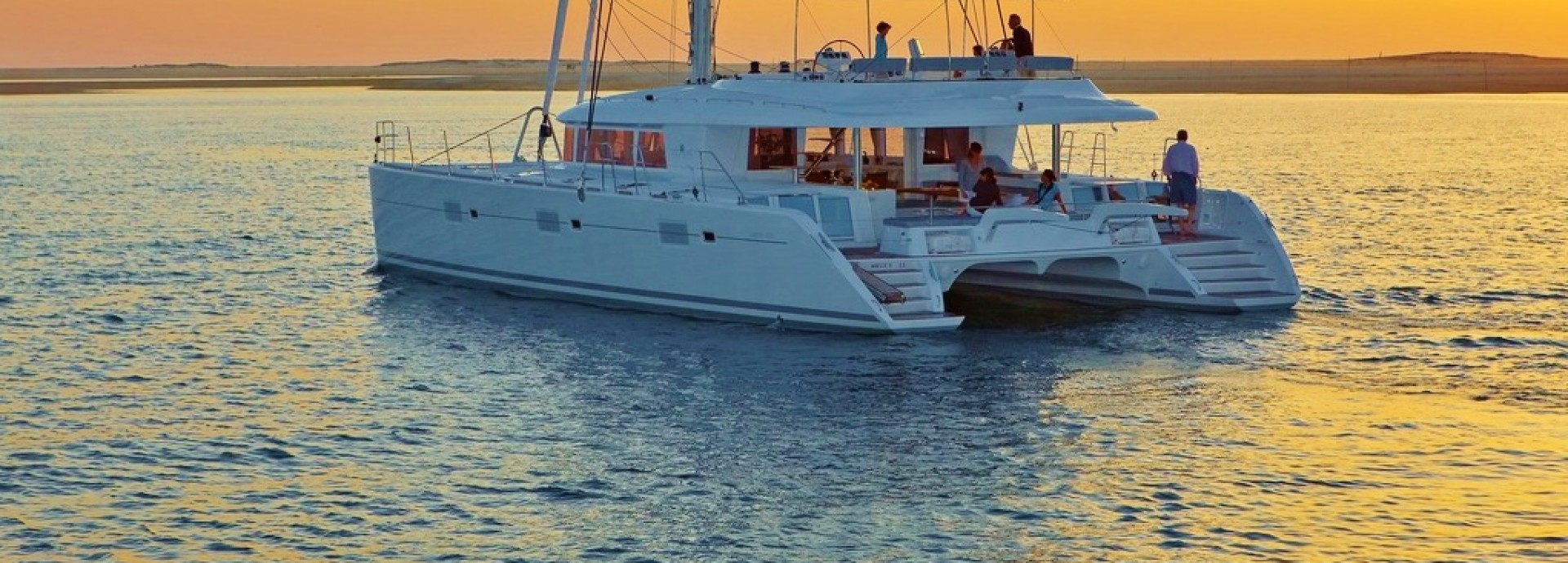 Lagoon 620 Anchored at Sunset