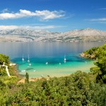 Lovrecina Beach on Brac Islands with yachts in bay