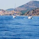 Boats motoring in the Saronic Islands by Patrick Bellew