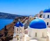 Panoramic view Santorini with blue domed church